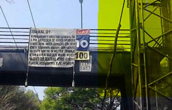 A narco sign hangs from a Mexico City overpass.