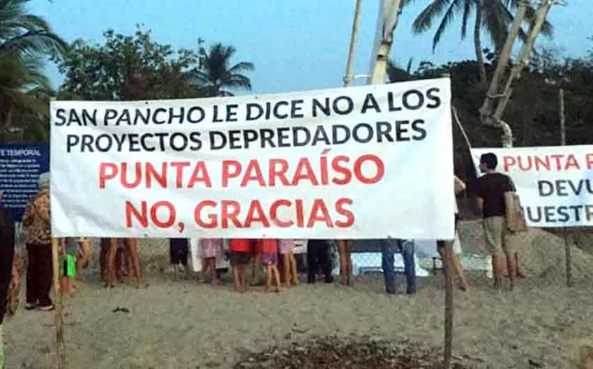 A sign in San Pancho: 'San Pancho says no to predatory projects.'