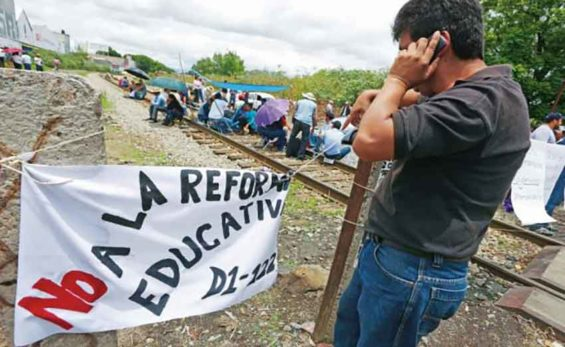 Teachers block a rail line in Michoacán.