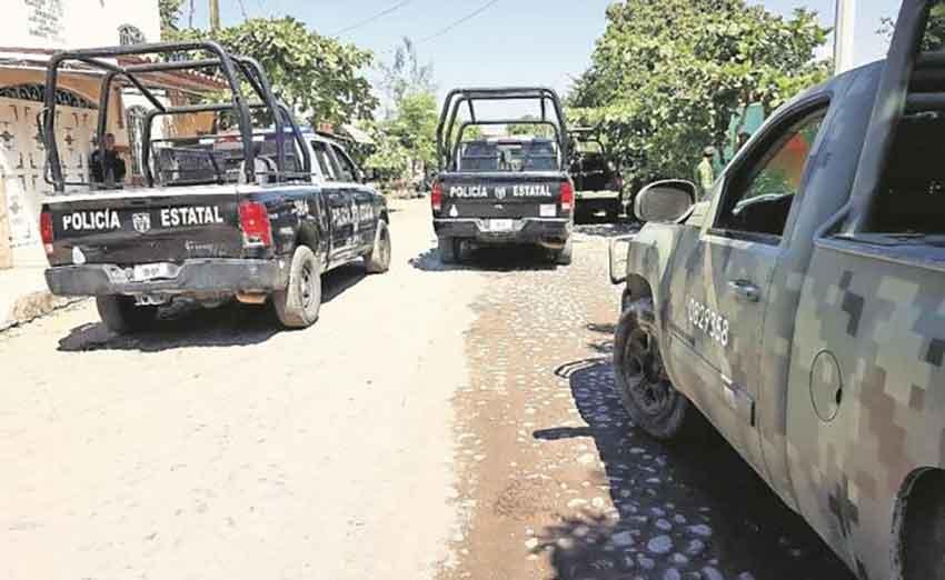 Police, military vehicles patrol Tecomán.