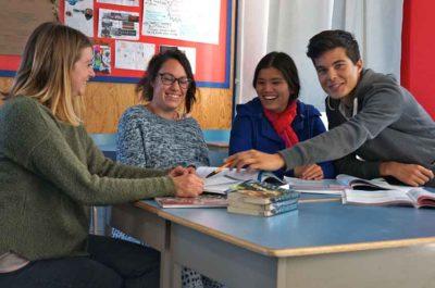 Teachers celebrate their student's Cambridge win.