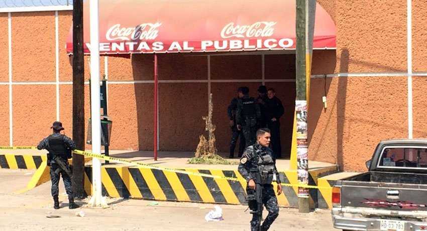 Police at the Coca-Cola distribution center, scene of an attack.