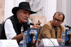 Mireles, left, speaks at Sunday's book launch.