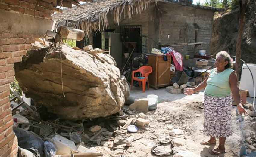 Colón and the huge rock that landed on her house.