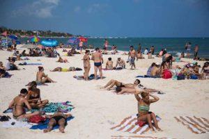 Visitors enjoy the beach in Playa del Carmen.