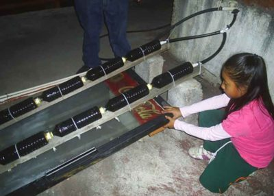 Xóchitl and her solar water heater.