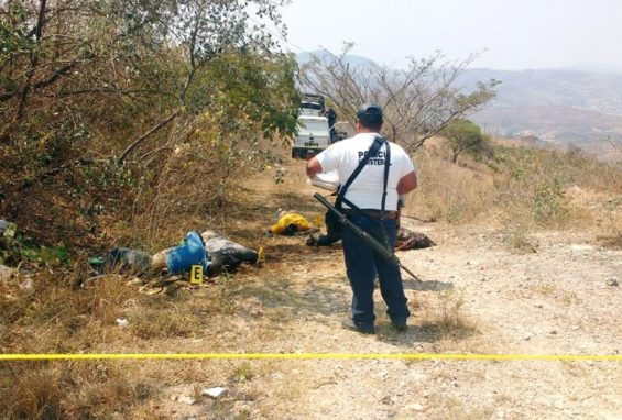Police officer at a murder scene in Chilapa yesterday.