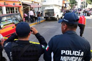 Police in Acapulco: not all have weapons.