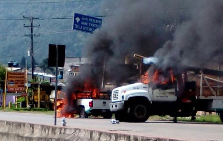 Trucks burn at Chiapas teachers' roadblock.