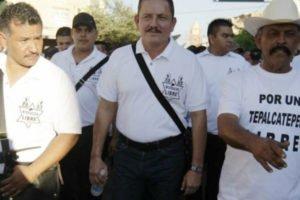 Alleged cartel operator Farías, center, when he was leader of a self-defense group.