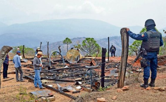 Remains of a home that was set on fire in Oaxaca territorial dispute.