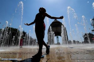 A youngster enjoys the fountains at the Monument to the Revolution in Mexico City.