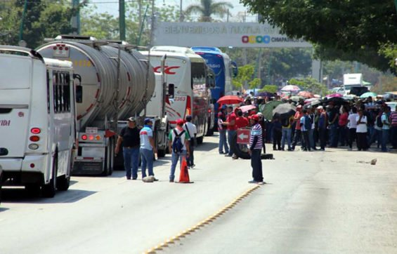 Traffic is backed up by a roadblock in Chiapas yesterday.