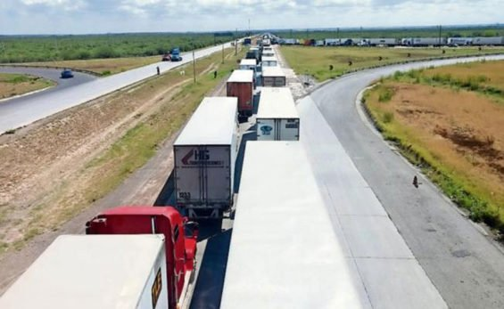 Trucks wait yesterday near the border.
