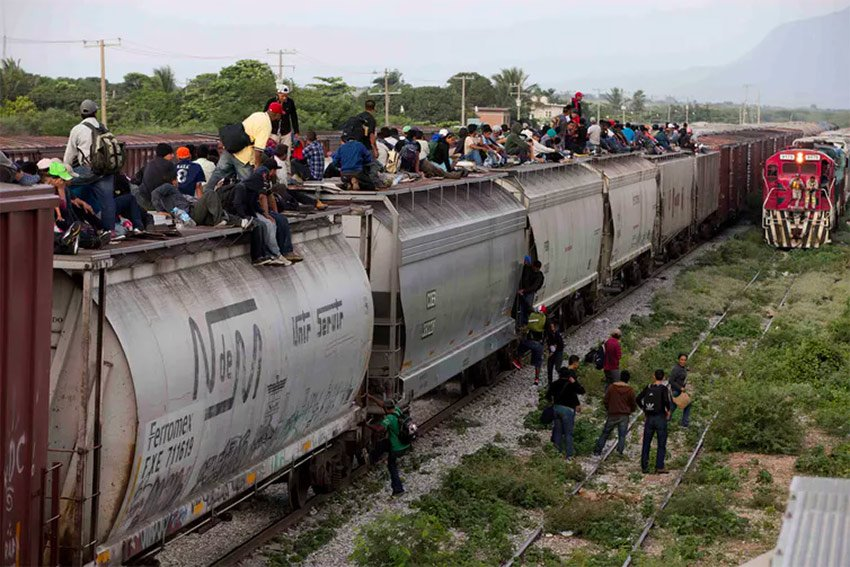 Migrants aboard the freight train nicknamed 'The Beast.'