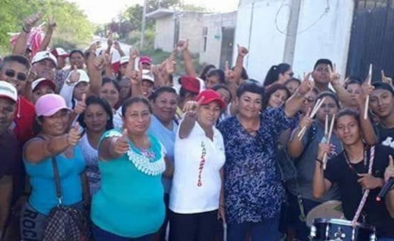 Candidate Magaña, center and wearing red hat, was attacked on Saturday.