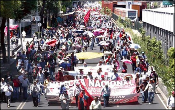 Protesting teachers march in Mexico City.