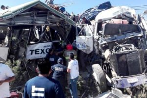The wreckage of a bus and truck in the accident that killed 11 yesterday.