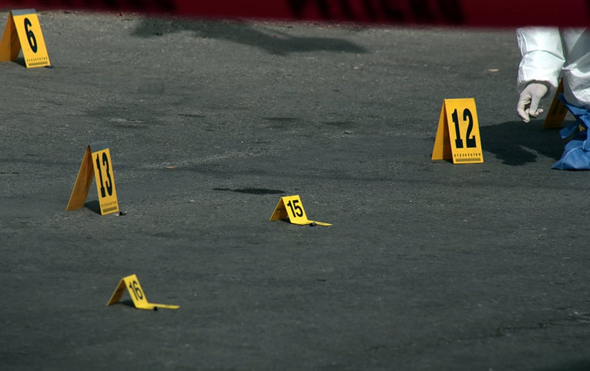 A homicide investigation, an all-too-common sight.