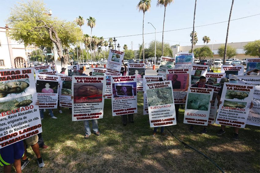 Posters tell the stories of the missing in Nuevo Laredo, describing them as 'victims of the navy.'