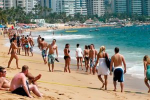 Tourists on an Acapulco beach: their numbers continue to rise.