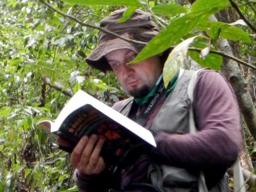 Botanist Viacheslav Shalisko checks his reference book.