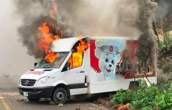 A Bimbo delivery truck burns in Acapulco.