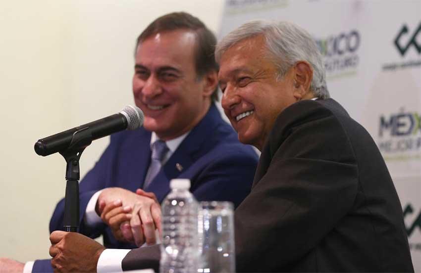 Castañon, left, and López Obrador shake on new agreement.