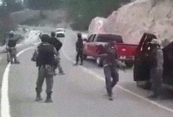 What appears to be a cartel convoy lined up on a highway in Mexico.