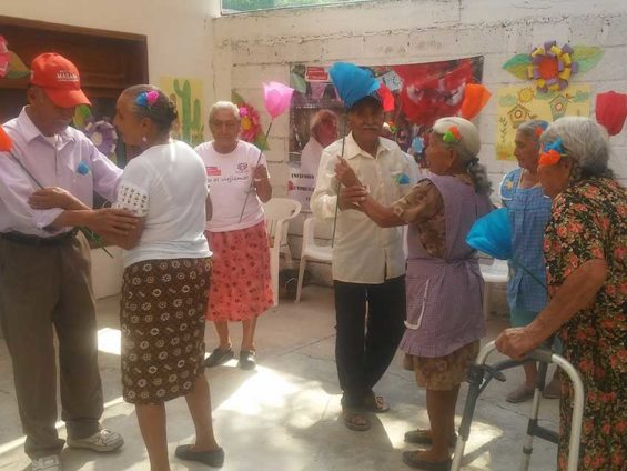 Seniors enjoy a dance at their community center.