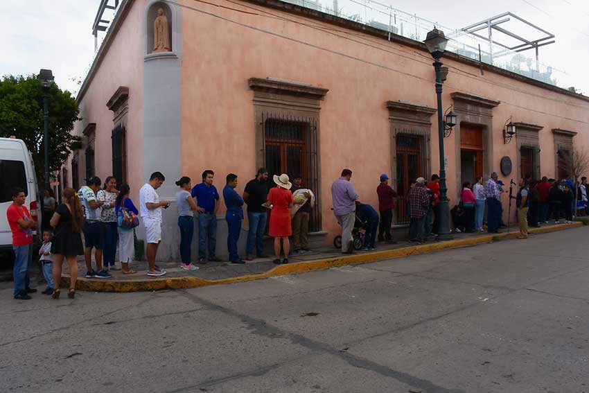 Voters line up at a polling station in Durango on July 1.