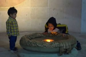 Happy birthday: a boy blows out the eternal flame in Guanajuato.