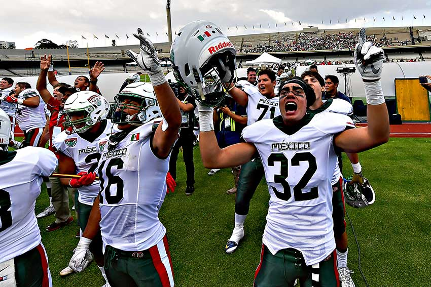 Mexico celebrates its football win yesterday over the US.