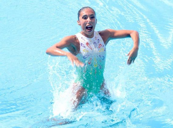 Joana Jiménez beams after her gold-medal performance in synchro swimming.