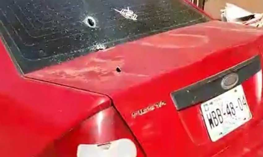 One of 11 vehicles damaged by gunfire in Guaymas.