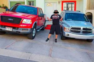 The alleged suspect with two of his luxury vehicles.