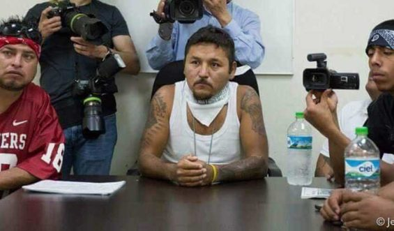 Former gangster 'El Mijis,' center, at a press conference.