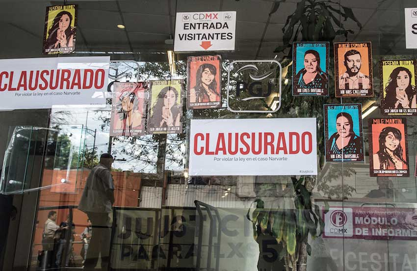 Posters placed on the window at the Mexico City Attorney General's office in protest against inaction on the homicide investigation.