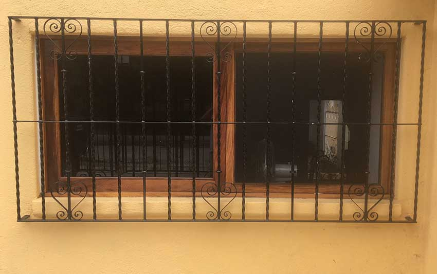 Security bars on a Mexican home. Unlike those in the story, these are mounted outside the frame.