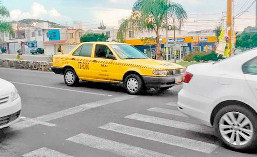 A taxi in Querétaro: they may still be yellow but they'll be green too.