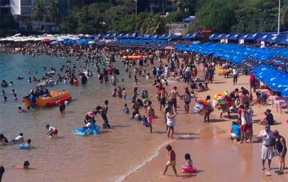 Visitors enjoy an Acapulco beach.