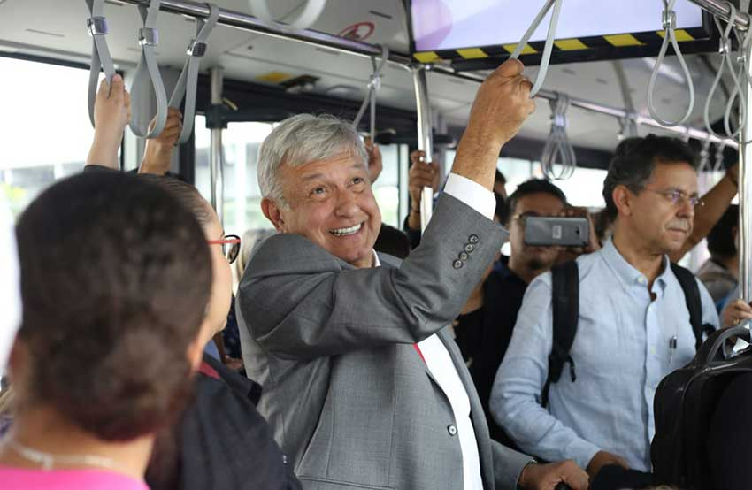 AMLO rides a Mexico City airport transport vehicle to catch a commercial flight to Juárez. He has vowed to fly commercial as president.