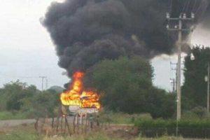 A vehicle burns at a Michoacán blockade.
