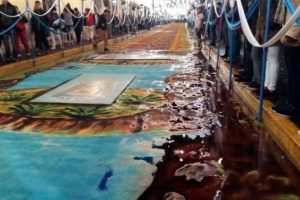 Rain washes away one of Huamantla's colorful carpets.