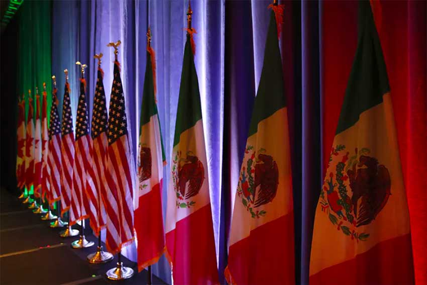 The national flags of Canada, the U.S. and Mexico are lit by stage lights before a news conference at the start of NAFTA renegotiations in Washington
