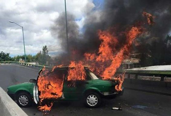 A taxi burns during cartel violence in Jalisco in 2015.