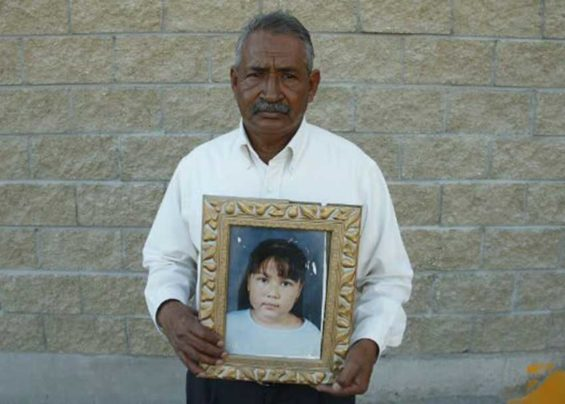 Castillo with a photo of his daughter, missing for more than nine years.