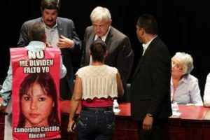 José Luis Castillo at yesterday's forum wearing his canvas sign that bears a photo of his missing daughter.