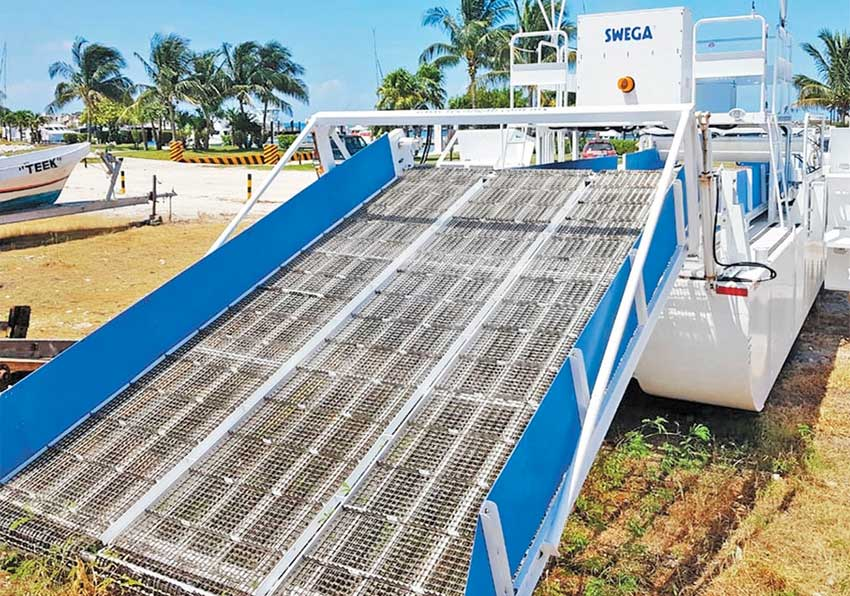 The sargassum removal vessel in dryland storage.