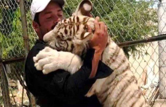 Lozano gets a tiger hug.